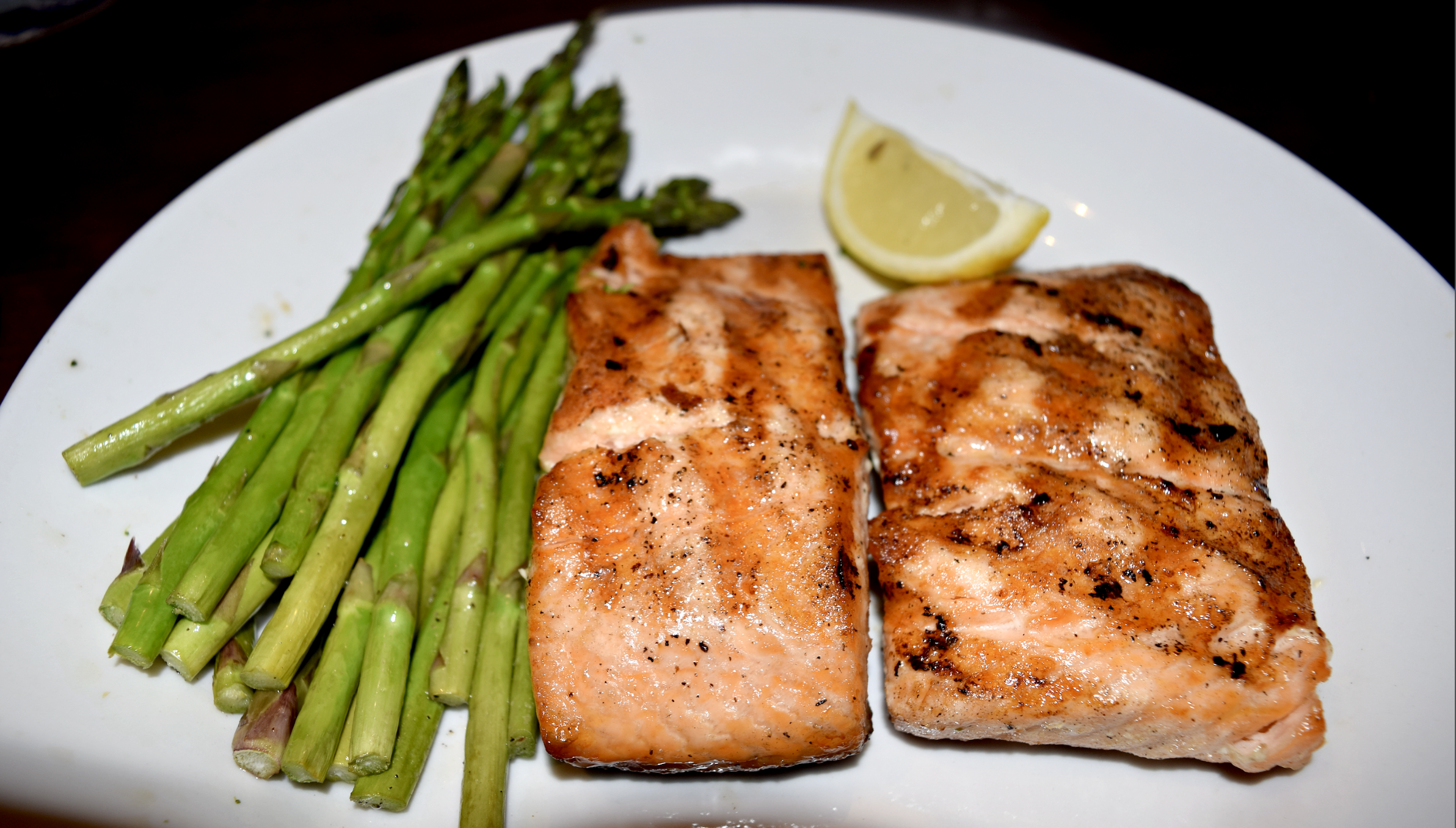 Blackened salmon with grilled asparagus and mashed sweet potatoes topped with chopped pecans and melted butter @ red Lobster - Manassas, Virginia