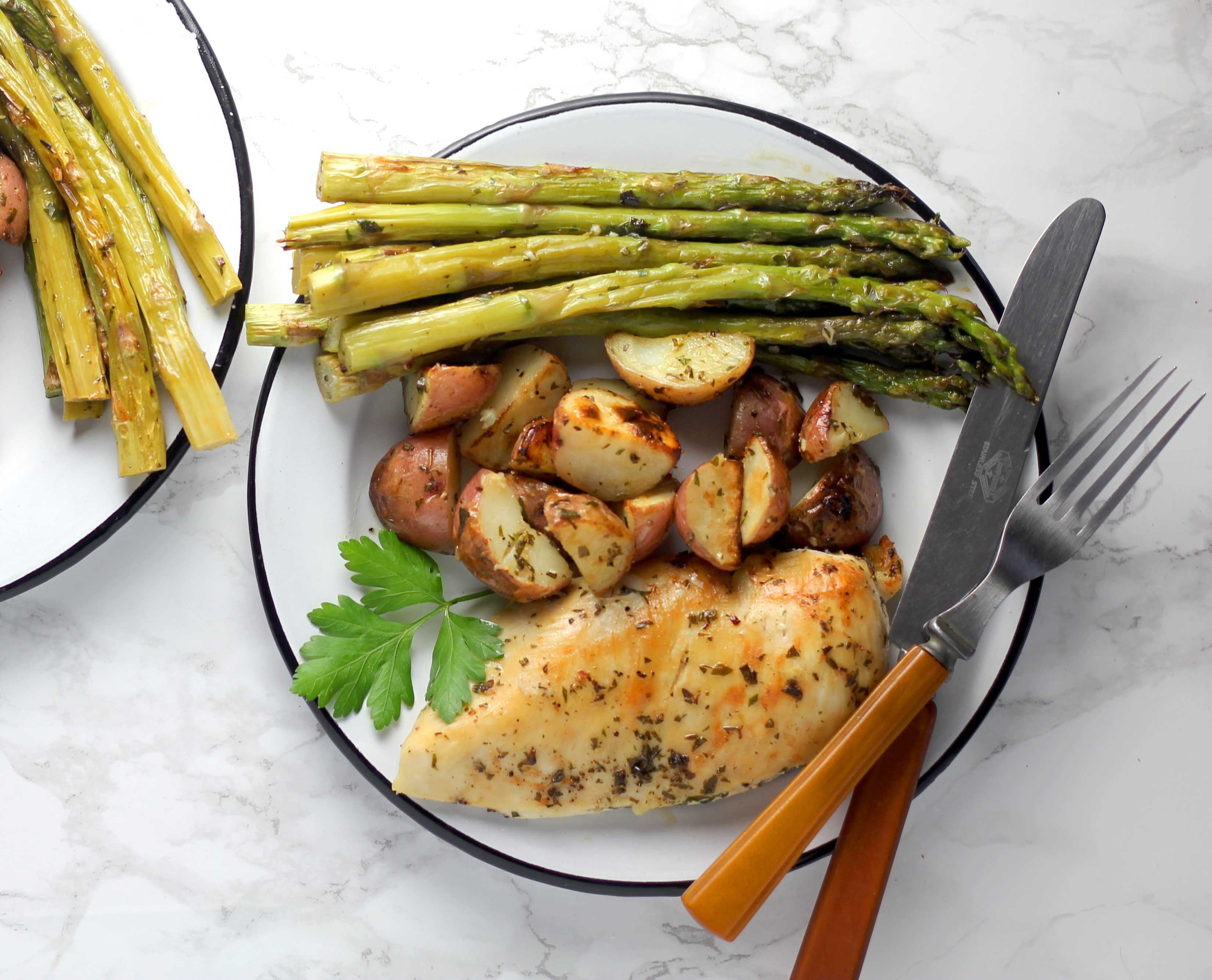 This quick and easy One-Pan Garlic Herb Butter Chicken with Potatoes and Asparagus makes a complete, satisfying dinner that's perfect for busy weeknights!