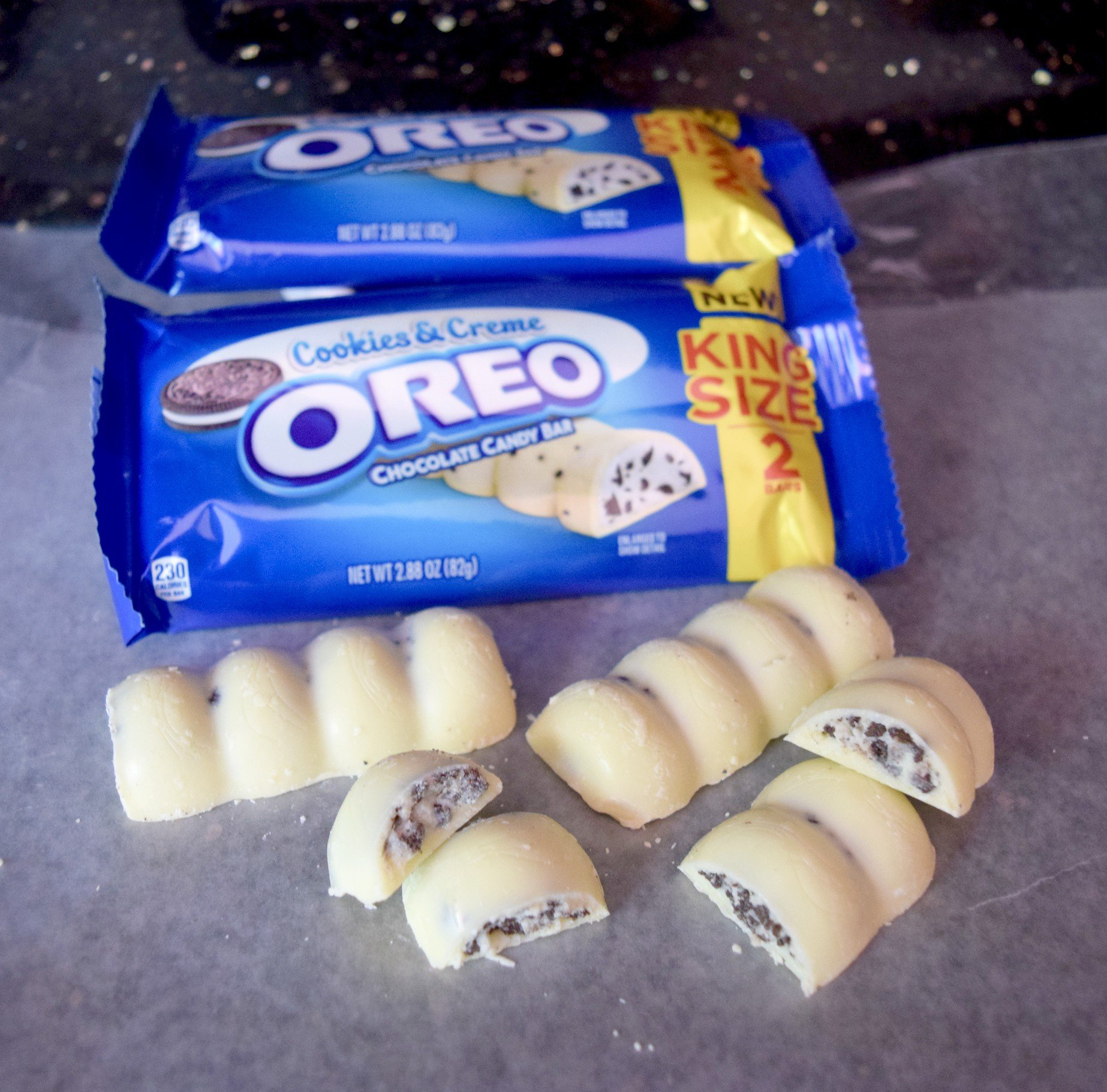OREO cookie pieces and Milka white chocolate candy come together to create the amazingly delicious OREO Cookies & Creme Chocolate Bar!