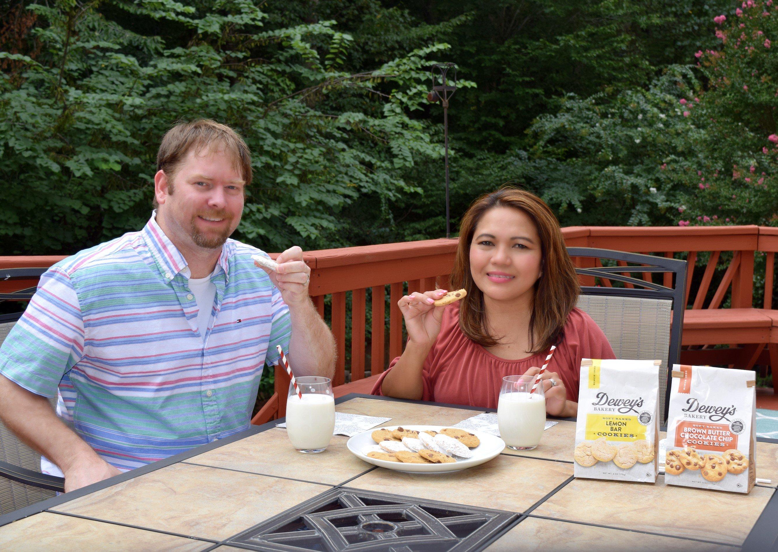 Happy husband and wife enjoying Dewey's Bakery Soft Baked Cookies