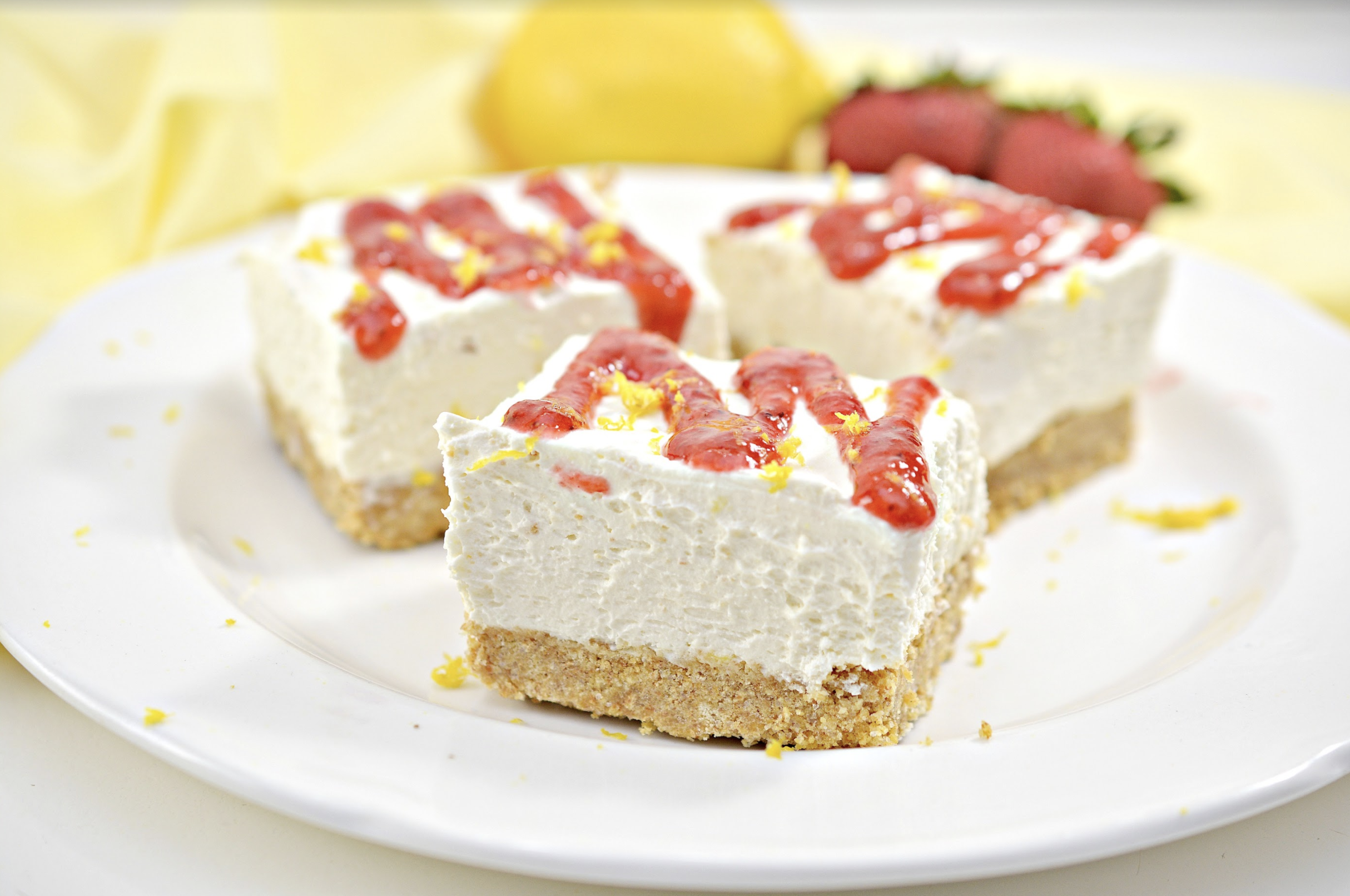 This easy, no-bake lemon and ricotta cheesecake bars recipe is the perfect summer dessert! The addition of creamy ricotta cheese makes it even lighter and tastier! #desserts #nobakedesserts #baking #easyrecipes #easydesserts #nobake #summerdesserts #dessertrecipes #cheesecake #cheesecakebars #foodblog #foodblogger #hipmamasplace #ad #galbanicheese #galbani #JuneDairyMonth #JDM2020