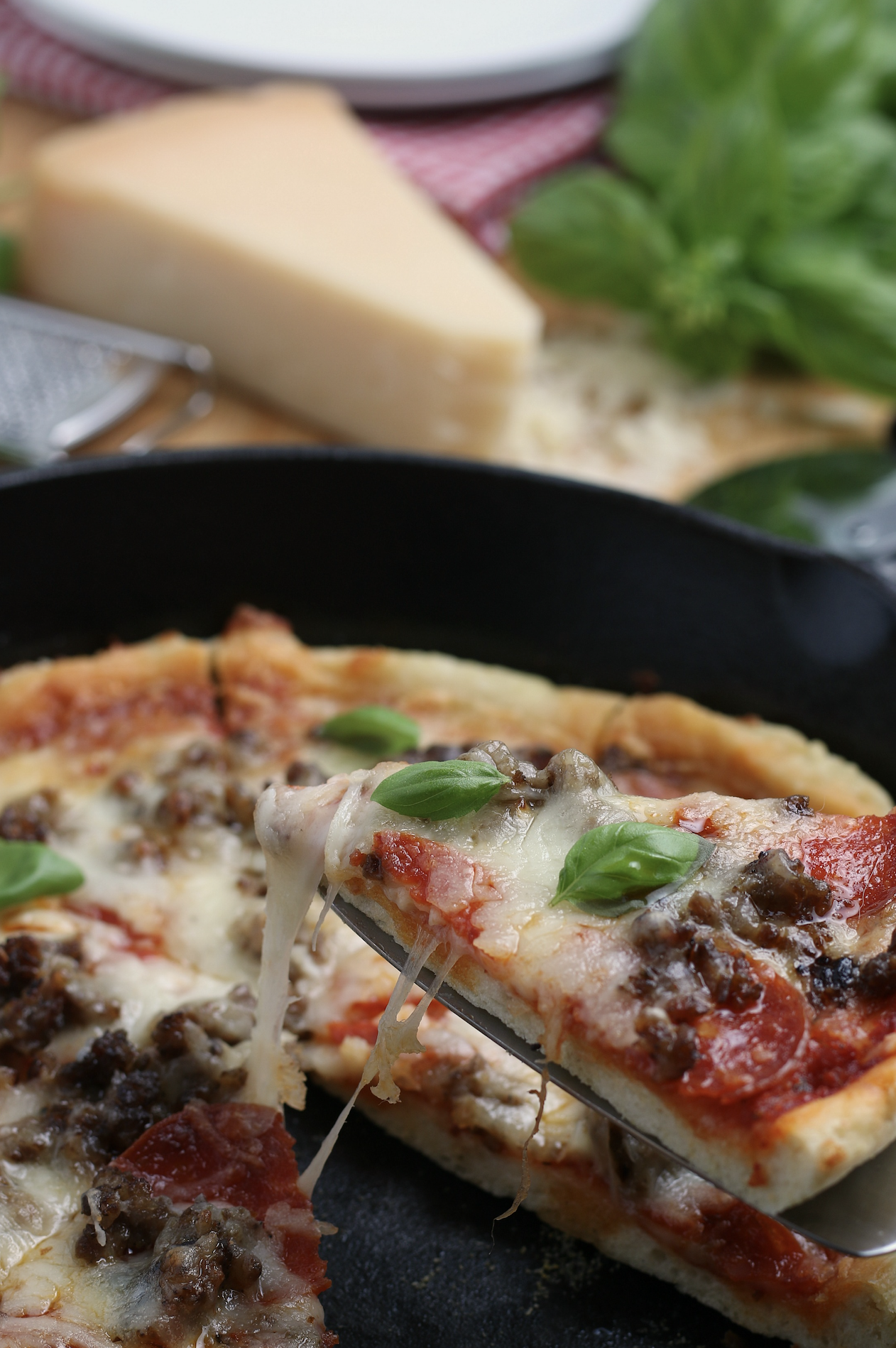 This quick, easy homemade Cast Iron Skillet Pizza recipe is the best homemade pizza you'll ever make! Get my recipe and try it today!